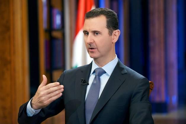 Sirski predsednik Bašar al Asad. (Foto - AFP Photo, Sana)