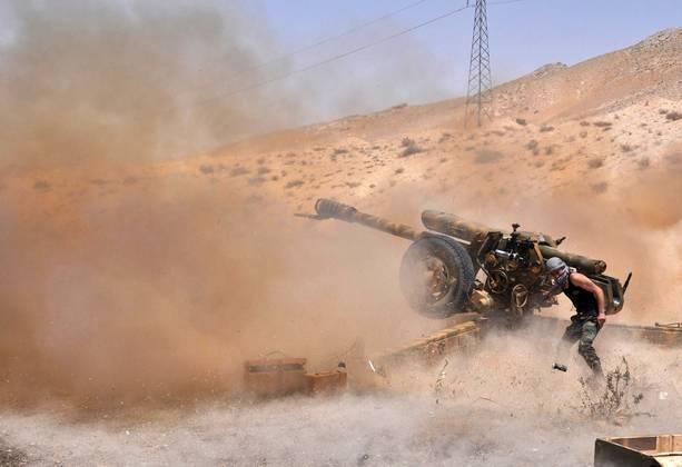 Pripadniki sirske vojske v bitki za mesto Palmira. (Foto - AFP Photo)