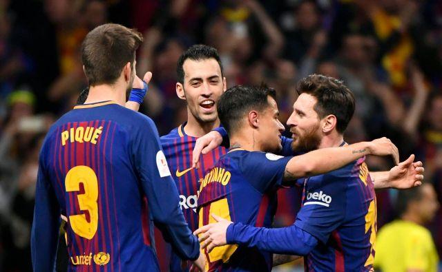 Nogometaši Barcelone so do vrha napolnili Sevillino mrežo. FotoPierre-Philippe Marcou/AFP