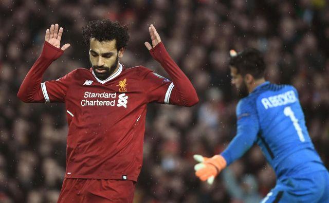 Mohamed Salah je k Liverpoolu prišel ravno iz Rome. FOTO: AFP