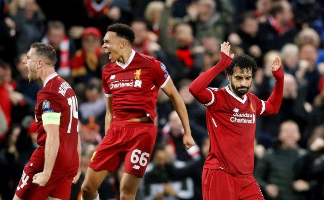 Angleški mediji so navdušeni nad Mohamedom Salahom (desno), ki se ni veselil doseženih golov proti Romi.
