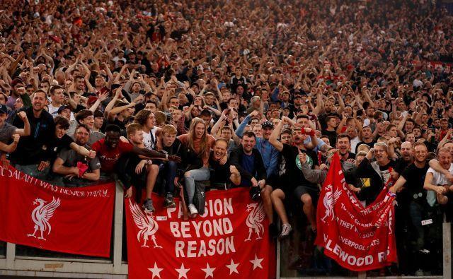 Navijači Liverpoola med slavjem na rimskem olimpijskem štadionu.