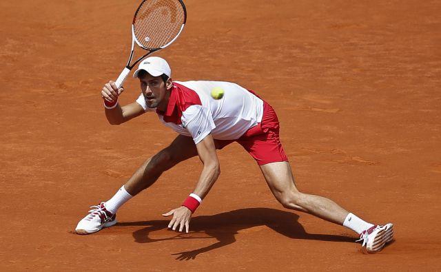 Novak Đoković se je dvakrat doslej okitil z madridsko lovoriko, letos je izpadel že po drugem dvoboju. FotoPaul White/AP
