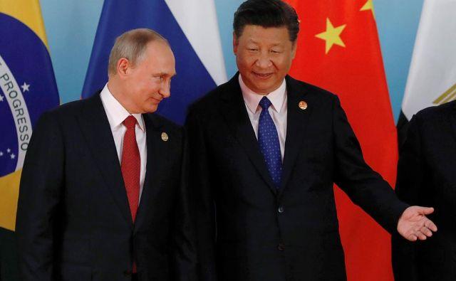 Kitajskega predsednika Xi Jinpinga nekateri imenujejo »Putin plus«, saj naj bi bil učinkovitejši in močnejši od ruskega predsednika. FOTO: Reuters