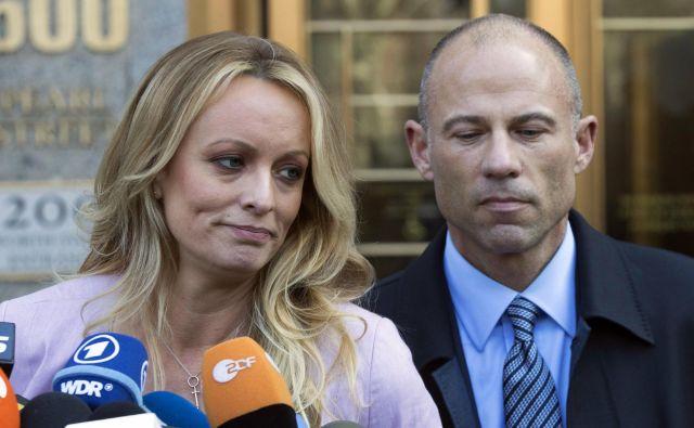 Stormy Daniels s pravim imenom Stephanie Clifford in njen odvetnik Michael Avenatti. FOTO: Mary Altaffer/AP