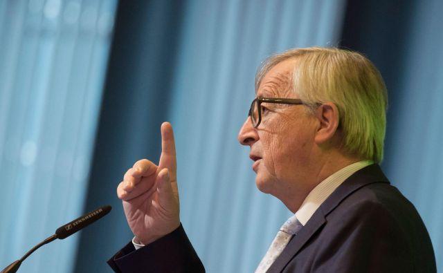 Jean Claude Juncker poudarja, da imajo dolžnost zaščititi evropska podjetja. FOTO: John Thys/Afp