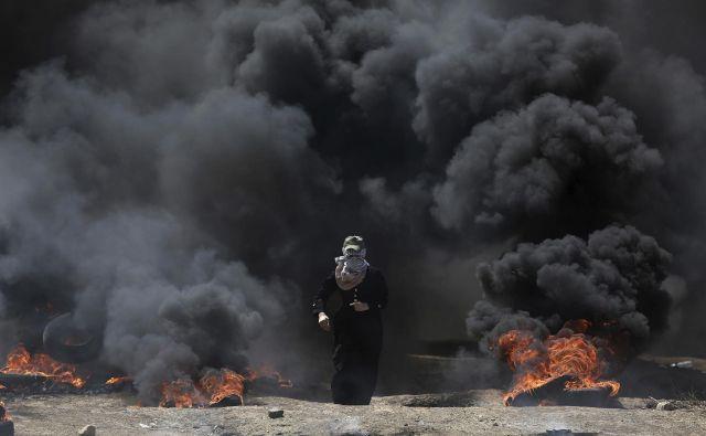 Svet ZN za človekove pravice se je na zahtevo več držav v petek sestal na izrednem zasedanju zaradi nedavnega nasilja na območju Gaze. FOTO: Khalil Hamra/AP