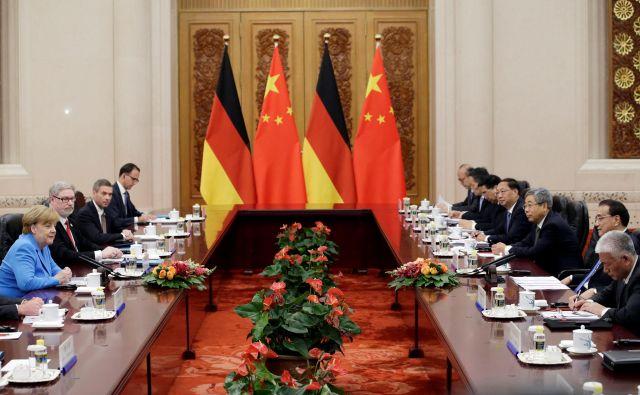 Pogovori med državama se bodo nadaljevali že 9. julija v Berlinu, ko bodo potekale skupne konzultacije nemške in kitajske vlade. FOTO: Jason Lee/Reuters