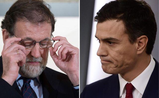 Premier Mariano Rajoy (levo) in vodja največje opozicijske stranke PSOE Pedro Sánchez. FOTO: Pierre-Philippe Marcou/AFP
