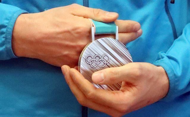 Vse nagrade, ki jih Olimpijski komiste Slovenije izplača športnikom, so obdavčene. FOTO: Igor Mali