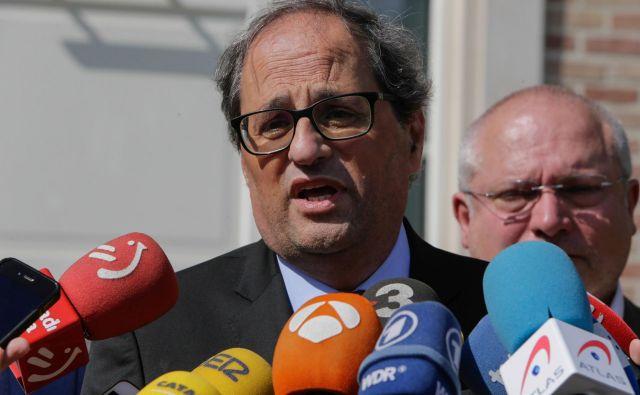 Torrova vlada je s prisego uradno prevzela dolžnosti, s čimer je bil samodejno odpravljen nadzor Madrida nad sicer avtonomno pokrajino na severovzhodu Španije. FOTO: AFP
