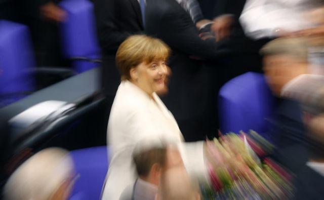Merklova naj bi vedela za številne nepravilnosti. FOTO: Kai Pfaffenbach/Reuters