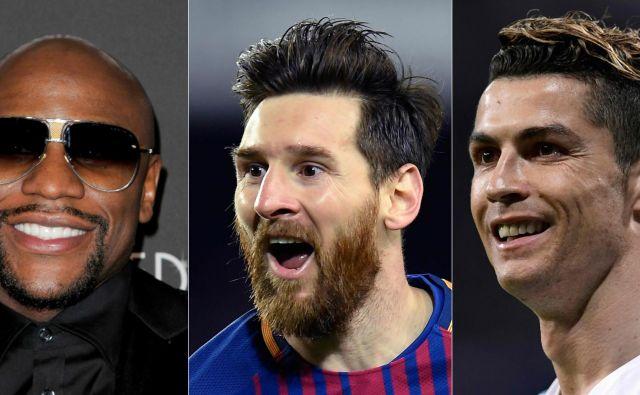 Oba nogometna asa sta skupaj zaslužila manj kot Floyd Mayweather. Foto Javier Soriano/AFP