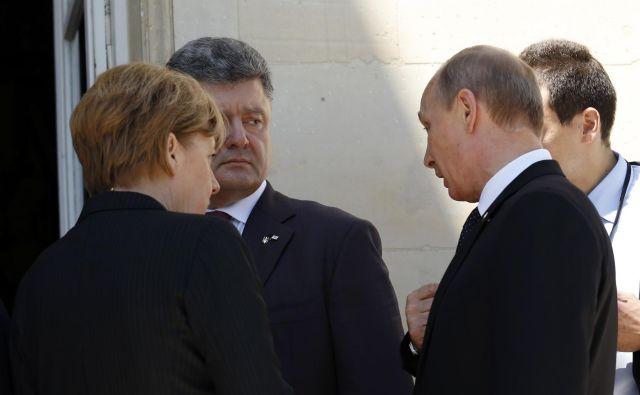 Voditelja sta v telefonskem pogovoru po navedbah Kremlja med drugim razpravljala tudi o konfliktu v vzhodni Ukrajini (fotografija je arhivska). FOTO: Kevin Lamarque/Reuters
