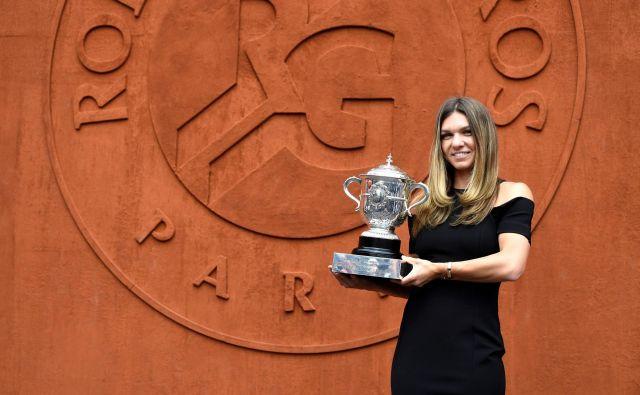 Odkar se je pri 14 letih Simona Halep odločila, da se bo profesionalno ukvarjala s tenisom, je sanjala o zmagi za veliki slam. Foto AFP