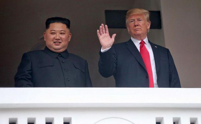 Kim Džong Un in Donald Trump FOTO: Kevin Lim/AFP