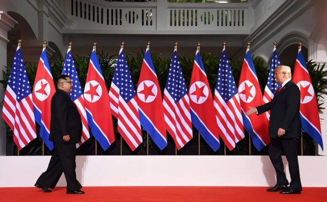 Donald Trump in Kim Džong Un FOTO AFP