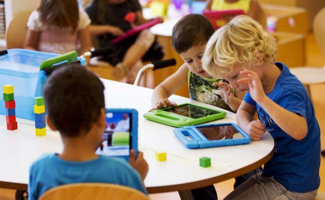 Bistvo uvedbe tabličnih računalnikov v vrtce in šole je privzgajanje računalniškega mišljenja, ki je povezano z naravoslovjem. FOTO Reuters