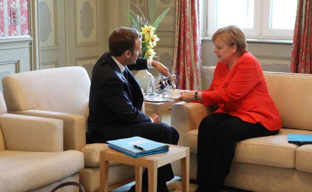 Merklova in Macron podpirata načrte evropske komisije in avstrijskega predsedovanja svetu EU za okrepljeno varovanje zunanjih meja. FOTO: AFP