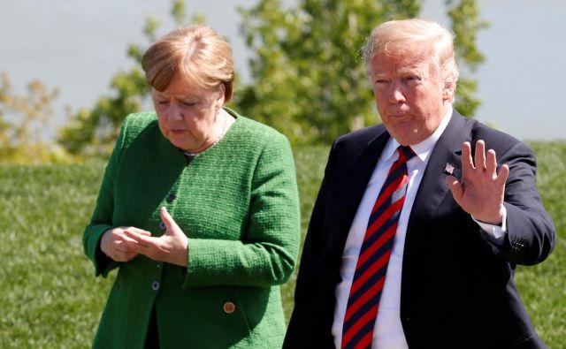 Trump kot vzrok za zaostrovanje svoje migrantske politike navaja tudi Nemčijo. FOTO: Yves Herman/Reuters
