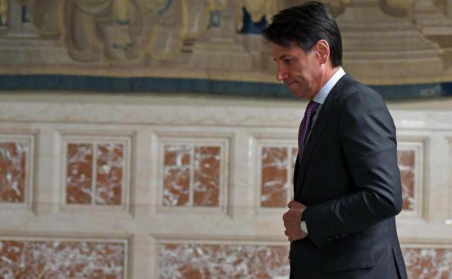 Conte je dejal, da Italija svojih stališč ne bo spremenila. FOTO:Ettore Ferrari/AP