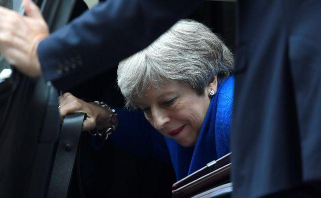 Vlada Therese May (na fotografiji) je zadnji sklop pomembnih glasovanj prestala s tesno večino. FOTO: Reuters