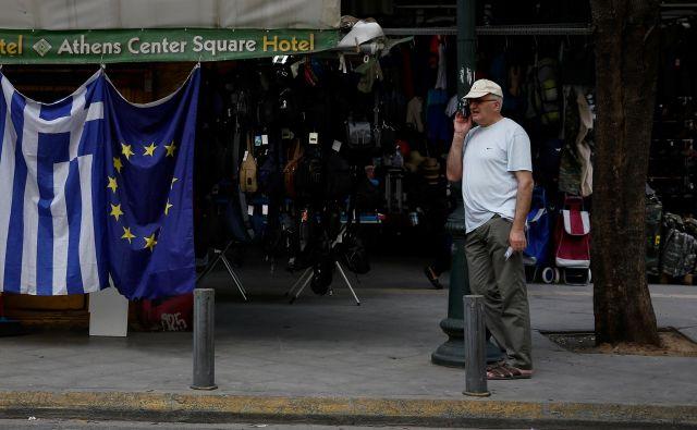 Grčija se sicer zavezuje, da bo do leta 2022 zagotavljala primarni presežek v vrednosti 3,5 odstotka BDP. FOTO: Costas Baltas/Reuters