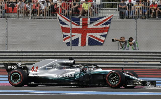 Lewis Hamilton je zmagal tretjič v sezoni. Foto Claude Paris/AP