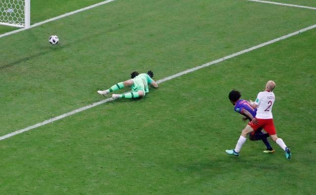 Juan Cuadrado je potrdil kolumbijsko zmago. Foto Jorge Silva/Reuters