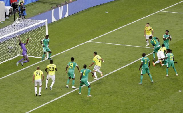 Yerry Mina je Kolumbijo popeljal v osmino finala. Foto Gregorio Borgia/AP