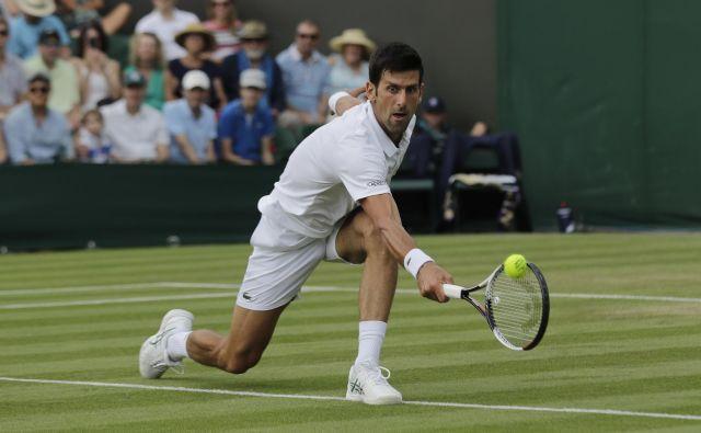 Novak Đoković je v dveh dvobojih skupaj oddal le 12 iger. Foto Ben Curtis/AP
