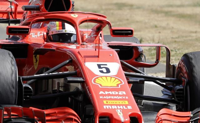 Sebastian Vettel je najbolje začel in najbolje končal dirko. Foto Luca Bruno/AP