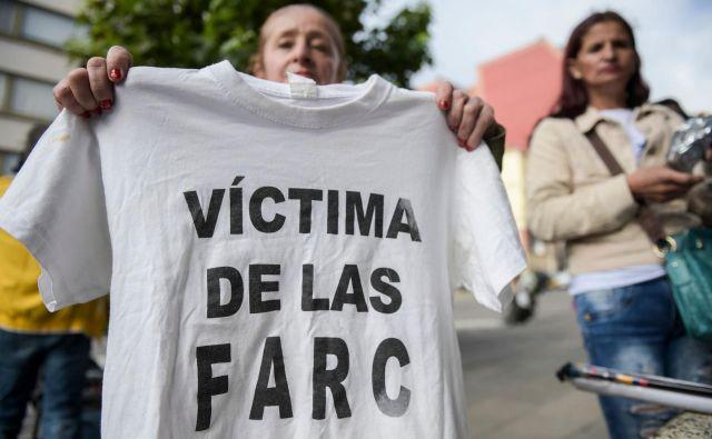 Veliko družin je trpelo bolečino, strah in nepovratno izgubo. FOTO: Raul Arboleda/Afp