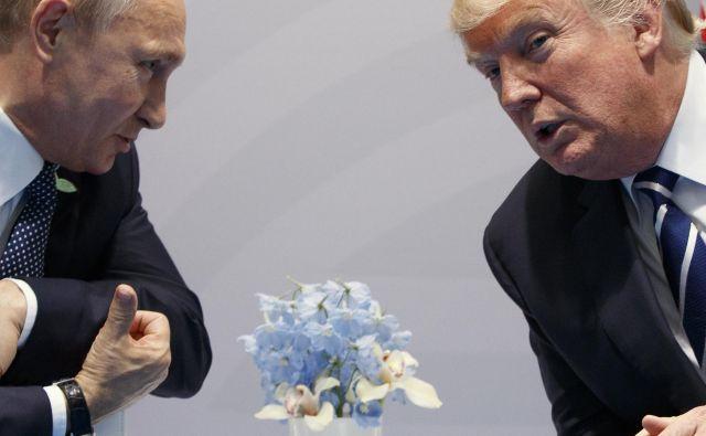Donald Trump in Vladimir Putin FOTO: Evan Vucci/AP