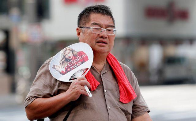 Občutek vročine je še hujši zaradi visoke vlage. FOTO: Reuters