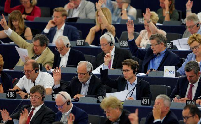 Od osmih slovenskih poslancev sta dodatno zaslužila dva. FOTO: Reuters