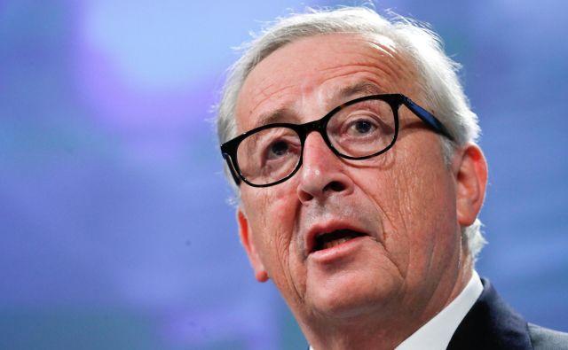 Predsednik evropske komisije Jean-Claude Juncker vztraja, da se bosta s Trumpov pogajala na enakovredni osnovi. FOTO: REUTERS/Yves Herman