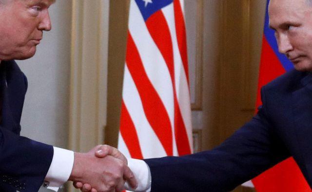 »Želi se srečati in jaz sem pripravljen,« je dejal Putin glede Trumpa, a poudaril, da bodo pred tem morali biti izpolnjeni določeni pogoji. FOTO: Kevin Lamarque/Reuters