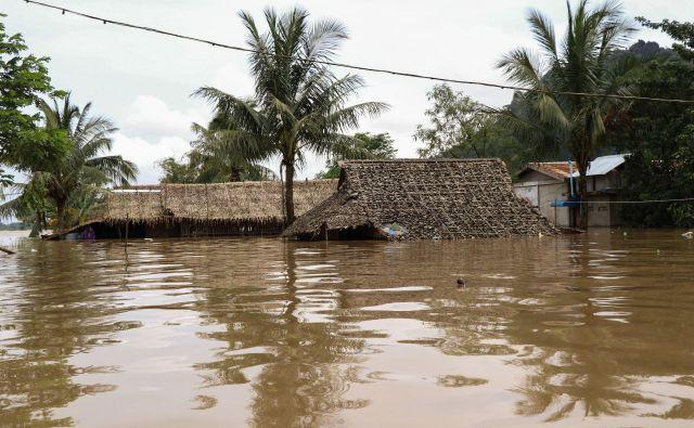 Obilno deževje v Burmi se danes nadaljuje. FOTO: Sau Kjau San Oo/AFP