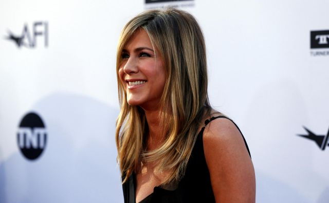 """Jennifer<a href=""""https://www.delo.si/magazin/zanimivosti/dosmrtna-urednica-ameriskega-vogua-77989.html"""" target=""""_blank""""> </a>Aniston se pogosto znajde v medijih, ko se ugiba, ali je (končno) noseča. FOTO: Mario Anzuoni/Reuters"""