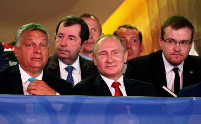 Ruski predsednik Vladimir Putin z madžarskim premierom Viktorjem Orbanom.FOTO: Laszlo Balogh/Reuters