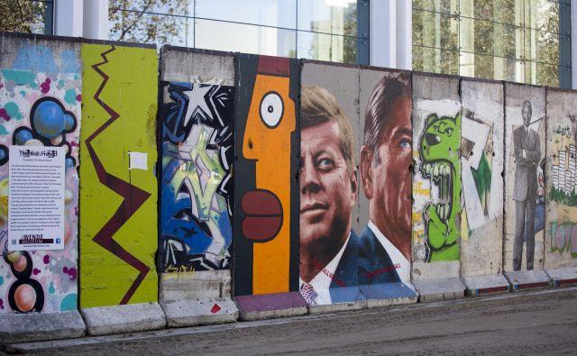 Berlinski zid je postal simbol hladne vojne, vzhodni in zahodni del Berlina pa je delil med letoma 1961 in 1989. FOTO: Mario Anzuoni/Reuters