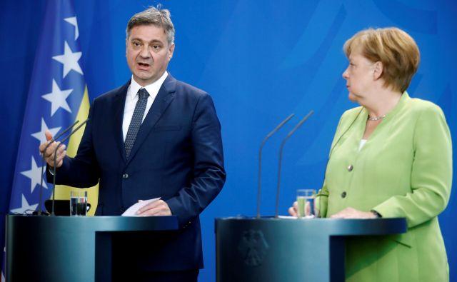 Na spletni strani nemške vlade so med drugim zapisali, da bo Nemčija še naprej zagotavljala potrebno podporo pri spoprijemanju s problematiko ilegalnega priseljevanja. FOTO: Hannibal Hanschke/Reuters