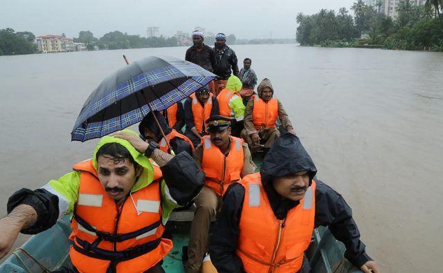 V zvezni državi Kerala ne pomnijo tako obilnega deževja. FOTO: AFP