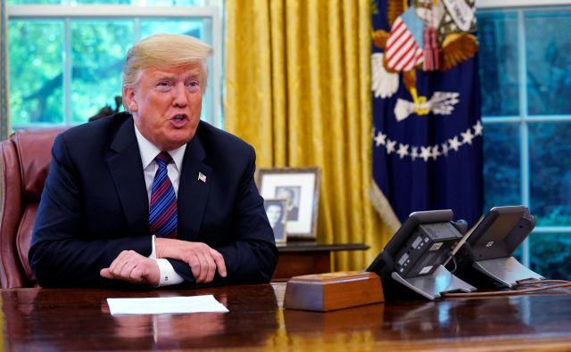 »To je velik dan za trgovino. Gre za res dober dogovor za obe državi,« je prepričan Trump. FOTO: Reuters/Kevin Lamarque