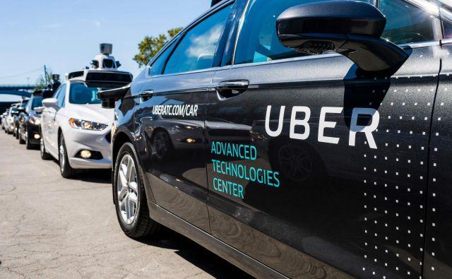 Tehnologija obeh podjetij bo v tem primeru integrirana v posebej za ta namen razvita vozila Toyote, ki bodo vozila prek Uberjeve platforme za naročanje prevozov. FOTO: Angelo Merendino / AFP