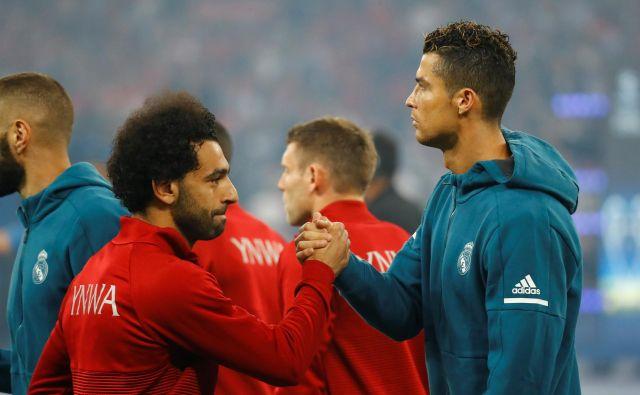 Mohamed Salah in Cristiano Ronaldo sta v ožjem izboru za nagrado Fife. FOTO: Reuters