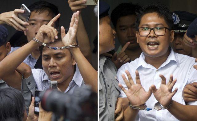 Kyaw Soe Oo (levo) in Wa Lone so obsodili zaradi poročanja o nasilju nad muslimansko manjšino. FOTO: Thein Zaw/AP