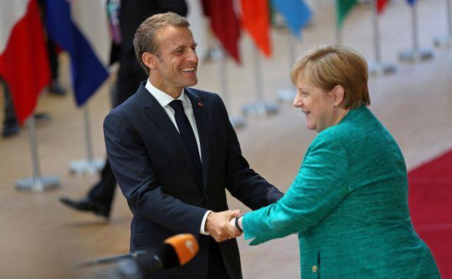 Francoski predsednik in nemška kanclerka se bosta danes srečala v Marseillu. FOTO: Reuters