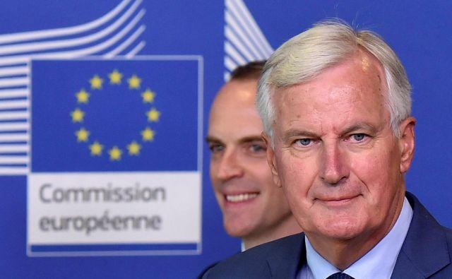Srečanja glavnega pogajalca EU Michela Barniera in britanskega sekretarja za brexit Dominica Raaba vse pogostejša. FOTO: Eric Vidal/Reuters